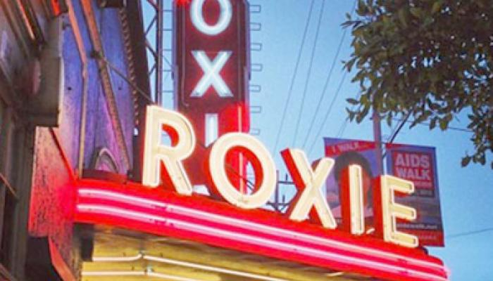 neon signage of the Roxy Theater