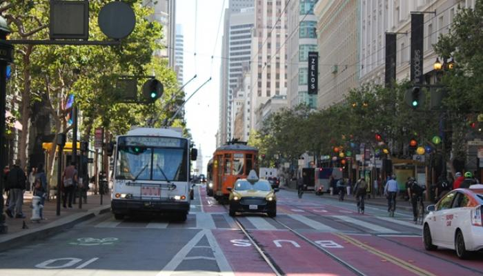 Image of Market Street with taxis and Muni