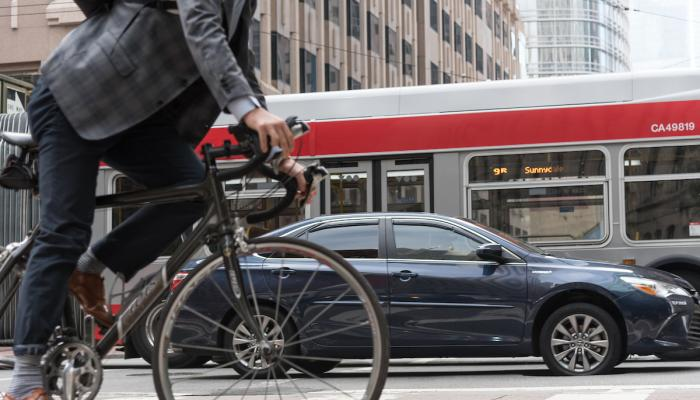 Bicycle, car and bus on Market Street - SFMTA