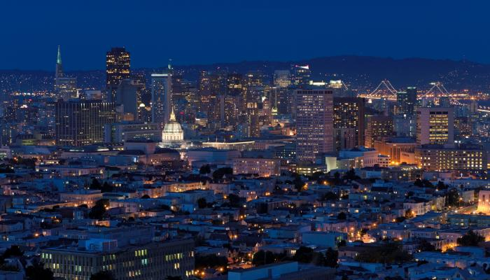San Francisco illuminated downtown skyline with City Hall