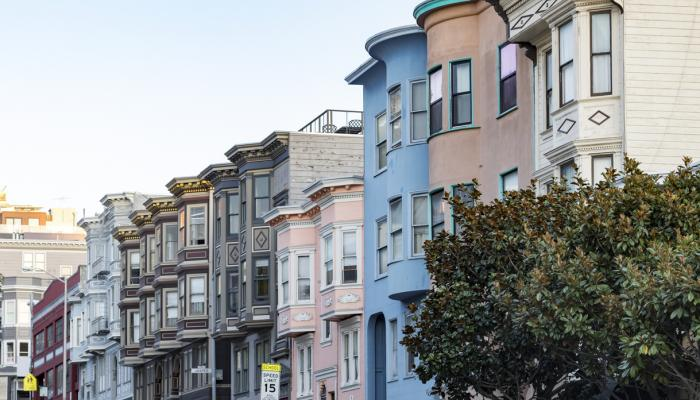 Row of historic pastel colored buildings with classic bay windows on Filbert Street