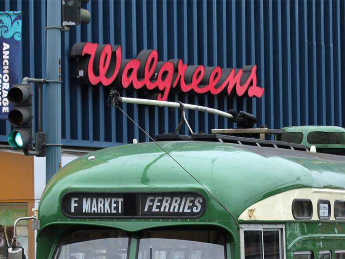 trolley in front of walgreens sign