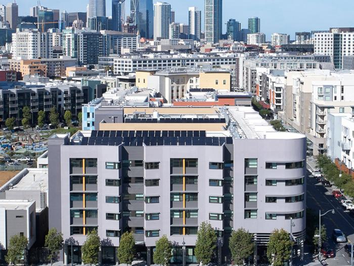 aerial view of large apartment building and view of downtown San Francisco