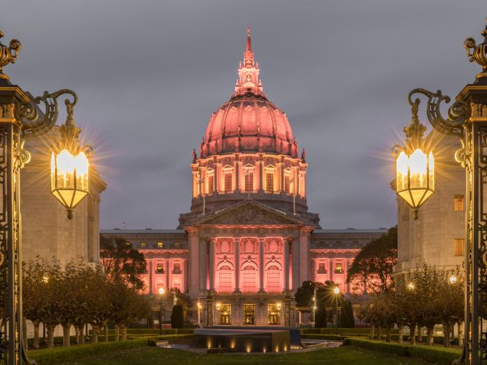 San Francisco City Hall illuminated in Amber from Fulton Street